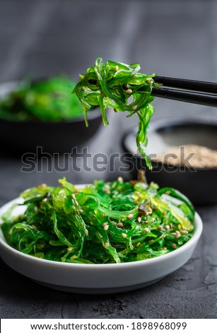 Traditional Japanese wakame salad with sesam seeds on black background. Healthy and fresh seaweed salad. Сток-фото ©
