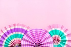 Traditional Japaneses festival paper fan with pink, turquoise, white stripes Birthday party, celebration holidays concept Abstract background Wall decor Banner