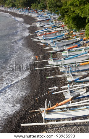 Traditional jukungs (outrigger fishing/sailing canoes) on Amed's 'Japanese Wreck' beach in Eastern Bali.