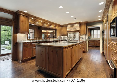 Traditional Kitchen In Luxury Home With Oak Wood Cabinetry Stock
