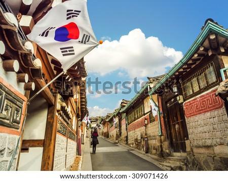 Photo of  Traditional Korean style architecture at Bukchon Hanok Village in Seoul, South Korea.