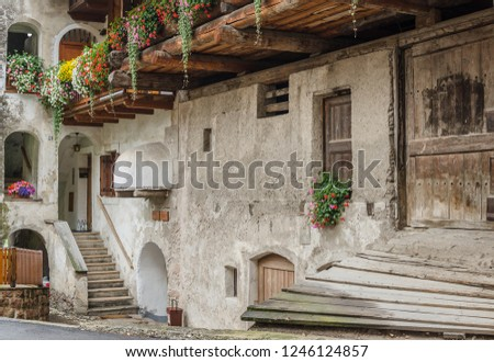 Traditional Ladin old houses in the streets of old commune of Predazzo, Fiemme valley, Dolomites, Trento, South Tyrol, Italy    Stok fotoğraf ©