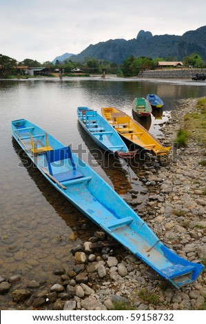 Traditional Laos longtail boat at Song river,Vang Vieng, Laos - stock photo