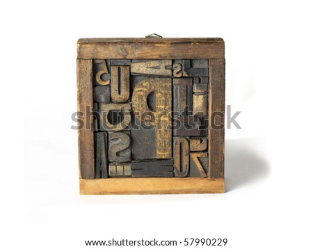 traditional letter press letters encapsulated into a wooden block