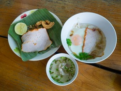 Traditional local food of Ban Na Ton Chan, Sukhothai province, Thailand made of rice noodle steamed and served with steamed egg, pork and soup