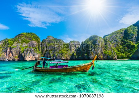 Traditional long tail boat on most beautiful famous Maya Bay on Phi Phi Islands, Thailand