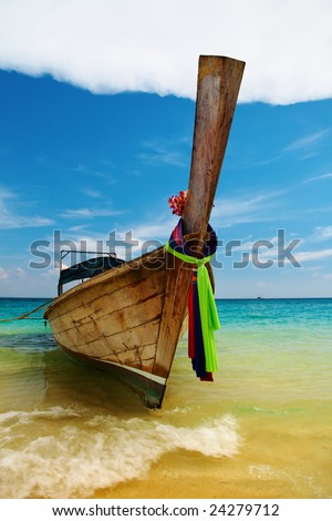 Traditional long tale boat, tropical beach, Thailand