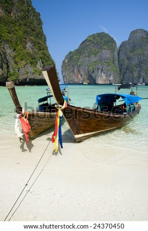 Traditional longtail boats in the famous Maya bay of Phi-phi Leh island, Krabi province, Thailand