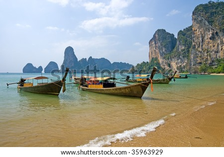 Traditional longtail boats on the Railay beach, Krabi province, Thailand