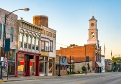 Traditional main street of quaint USA small town in midwest America with storefronts and  clock tower Paxton Illinois