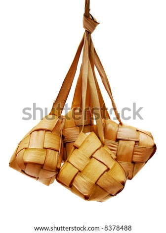 Traditional Malay compact glutinous rice called Ketupat for celebrations - stock photo
