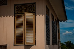 traditional Malay house wooden windows, in the daytime photo, Tanjungpinang, Riau Islands, Indonesia