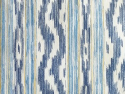 Traditional Mallorcan fabric texture with a pattern in the shape of blue and white tongues. Cushion fabric background made with natural fiber and bluish tint.