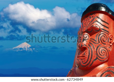 Traditional maori carving over Taranaki Mount background, New Zealand