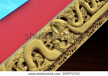 Traditional Maori wood carvings in a Marae (meeting house) in New Zealand.