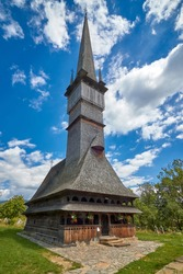 Traditional Maramures wooden architecture - the Church of the Archangels Michael and Gabriel in Surdesti, Maramures County near Baia Mare, Romania. UNESCO world heritage site