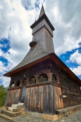 Traditional Maramures wooden architecture  - the Church of the Archangels Michael and Gabriel in Plopis, Maramures County near Baia Mare, Romania. UNESCO world heritage site
