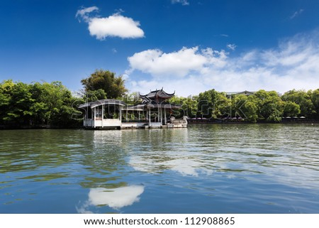 traditional marble boat and blue sky reflection in the lake,guilin,China