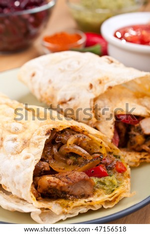 traditional mexican chicken and beef fajitas with guacamole