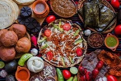 traditional Mexican food from Oaxaca Mexico, Tlayuda, Oaxaca Cheese, tamales and Chocolate. Oaxacan Gastronomy
