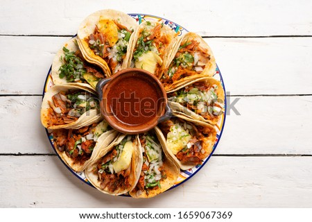 Traditional mexican pork tacos called 'Al pastor' with pineapple on white background Stok fotoğraf ©