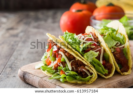 Traditional Mexican tacos with meat and vegetables on wooden background  #613957184
