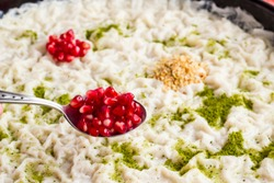 Traditional milky dessert Gullac,usually make in Ramadan with Gullac sheets,sugar,powder of pistachio,milk,hazelnuts and walnut inside if desired.Light and old dessert from Ottoman Cuisine.