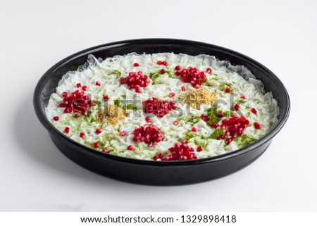 Traditional milky dessert Gullac,usually make in Ramadan with Gullac sheets,sugar,powder of pistachio,milk,hazelnuts and walnut inside if desired.Light and old dessert from Ottoman Cuisine. Stock photo ©