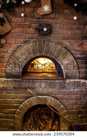 Traditional modern ovens for cooking and baking pizza, a burning fire in the oven