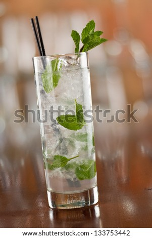 traditional mojito cocktail with fresh mint  served on a busy bar top