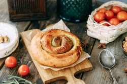 Traditional Moldovan and Romanian cake in the shape of a snail. Swirling round pie close-up.