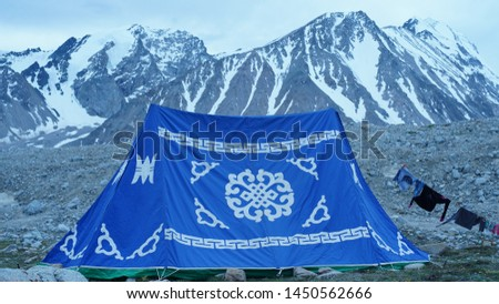 Traditional Mongolian tent in mountains  #1450562666