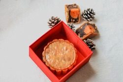Traditional Moon Cake inside a red box during the Mid-Autumn Festival or Moon cake Festival