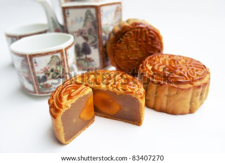 Traditional Mooncake with tea pot as background