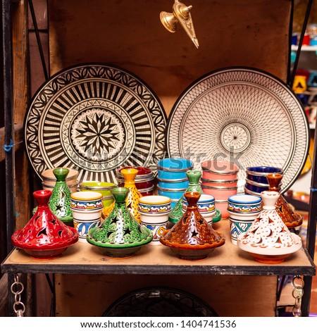 Traditional Moroccan marrakech market with plates and tajin tagine. Handmade ceramic plates. Arabian colorful ramadan design #1404741536