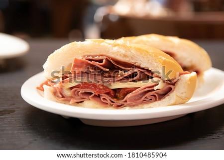Traditional mortadella sandwich from Mercado Municipal (Municipal Market) in Sao Paulo, Brazil. bologna snack. Bread with sliced pork. Foto stock ©
