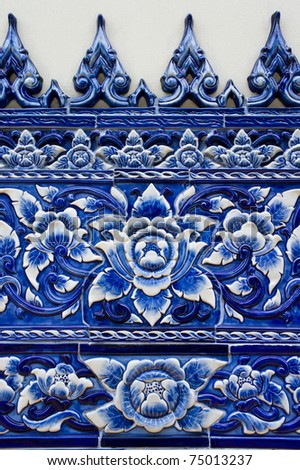 traditional mosaic wall in Thai temple - stock photo