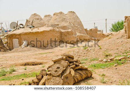 """Traditional mud brick """"beehive"""" houses in Harran and animal dung as fuel, Turkey"""
