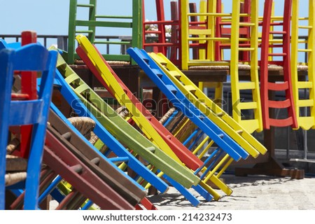 Traditional multicolored greek chairs in a taverna. Horizontal