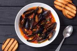 Traditional mussels tomato soup bouillabaisse. Seafood background .
