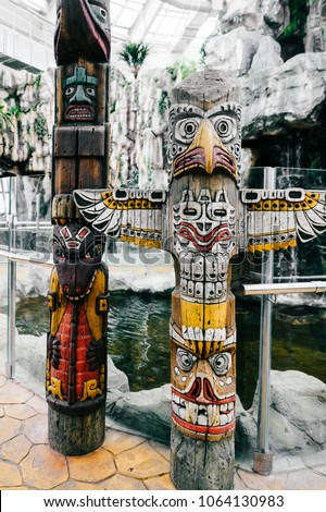 Traditional national indian totem.  Totem pole sculpture art. Ancient wooden mask.  Mayan and aztecs symbolic religious gods faces.  Ethnic pagan worship and idolatry. #1064130983