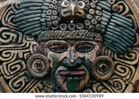 Traditional national indian totem.  Totem pole sculpture art. Ancient wooden mask.  Mayan and aztecs symbolic religious gods faces.  Ethnic pagan worship and idolatry. #1064130989