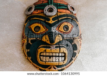 Traditional national indian totem.  Totem pole sculpture art. Ancient wooden mask.  Mayan and aztecs symbolic religious gods faces.  Ethnic pagan worship and idolatry. #1064130995
