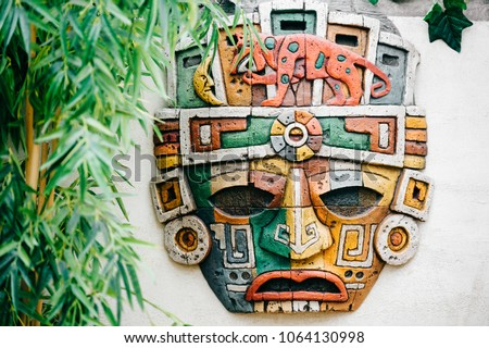 Traditional national indian totem.  Totem pole sculpture art. Ancient wooden mask.  Mayan and aztecs symbolic religious gods faces.  Ethnic pagan worship and idolatry. #1064130998