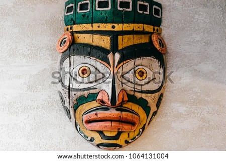 Traditional national indian totem.  Totem pole sculpture art. Ancient wooden mask.  Mayan and aztecs symbolic religious gods faces.  Ethnic pagan worship and idolatry. #1064131004