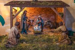 Traditional nativity scene with holy family in bethlehem at Christmas market