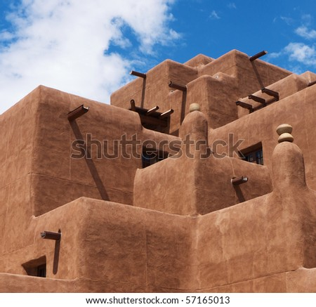 Traditional New Mexico adobe architecture against blue sky