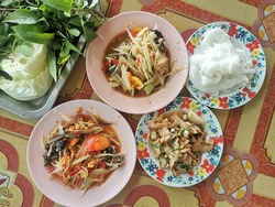 Traditional northeastern Thailand foods, Many variety various Isaan foods on a wooden table