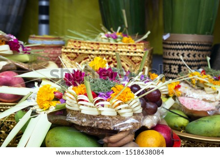 Traditional offerings to gods in Indonesia with flowers, fruits and aromatic sticks in temple, buddhist Bali