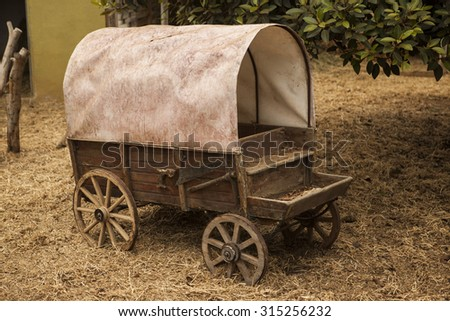 Traditional old American wagon with a roof. Wild west traditonal vintage old wagon  detail.